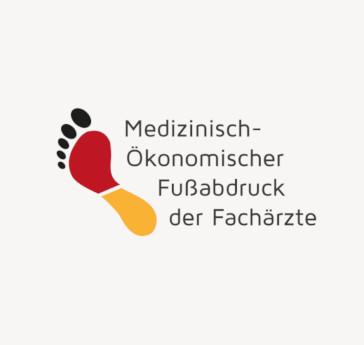 """Fußabdruck in Deutschlandfarben mit Schriftzug """"Medizinisch Ökonomischer Fußabdruck"""""""